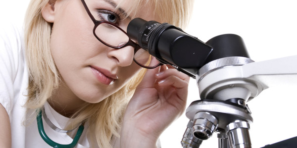 Scientist with microscope