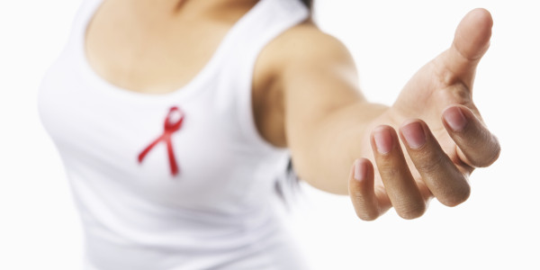 Woman giving her hand to give support for AIDS cause or breast c